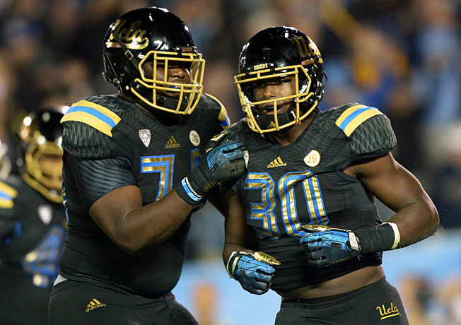 UCLA freshman Myles Jack (30) has played a key role for the Bruins as both a linebacker and a tailback.