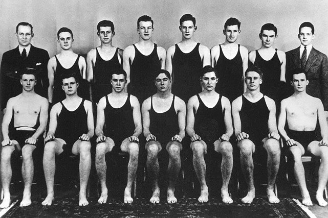 John F. Kennedy (back row, third from left) poses with fellow members of the Harvard Swimming Team circa 1935.