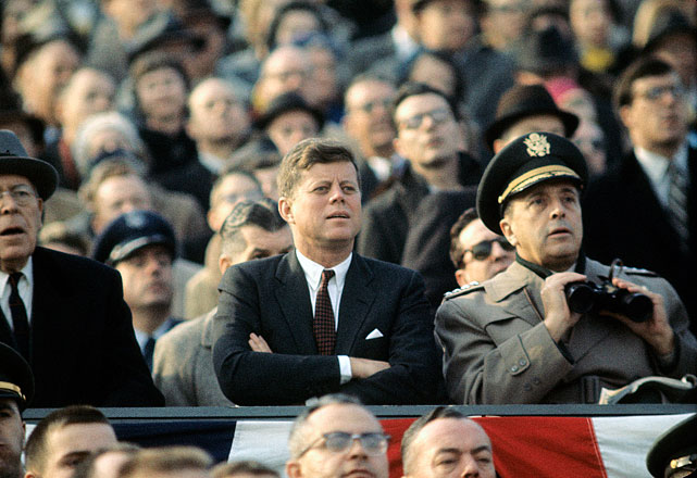 President John F. Kennedy sits in the stands watching the Army-Navy football game on the Army side at Philadelphia Municipal Stadium on Dec. 2, 1961.