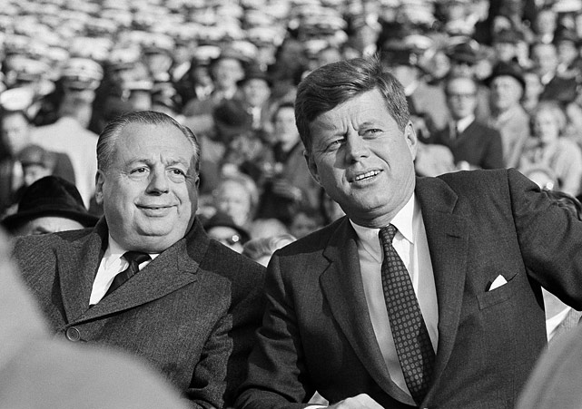 President John F. Kennedy sits with Ohio Governor Michael DiSalle on the Navy side as they watch the Army-Navy football game at Philadelphia Municipal Stadium on Dec. 2, 1961.