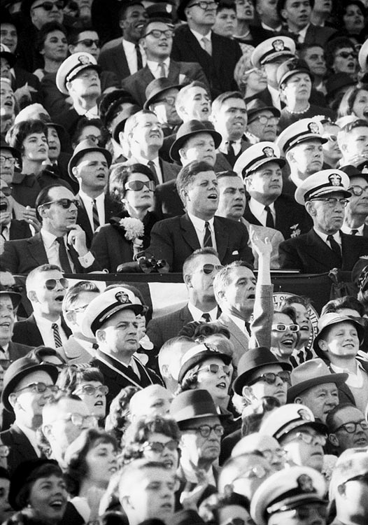 President John F. Kennedy sits in the stands watching the Army-Navy football game on the Navy side at Philadelphia Municipal Stadium on Dec. 1, 1962.
