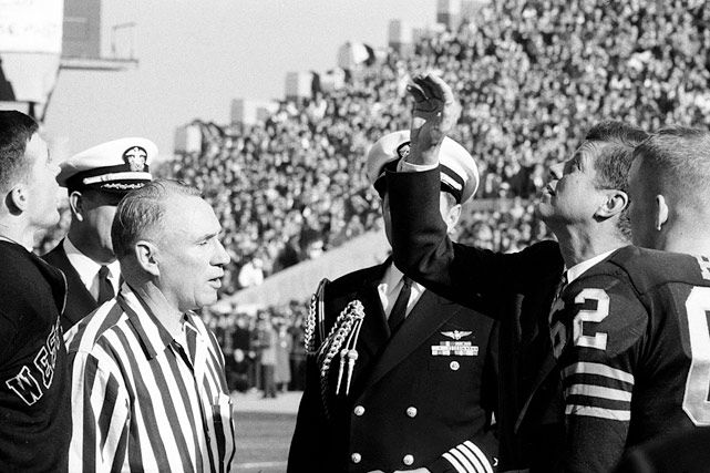 President John F. Kennedy handles the coin toss prior to the Army-Navy football game at Philadelphia Municipal Stadium on Dec. 1, 1962.