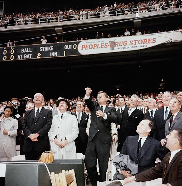 President John F. Kennedy throws out the first pitch at the opening day baseball game between the Washington Senators and Detroit Tigers on April 9, 1962 at Griffith Stadium in Washington, D.C.