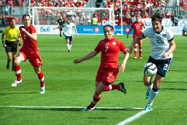 U.S. star Abby Wambach (20) and her women's national team teammates will open the 2014 slate against regional rival Canada.