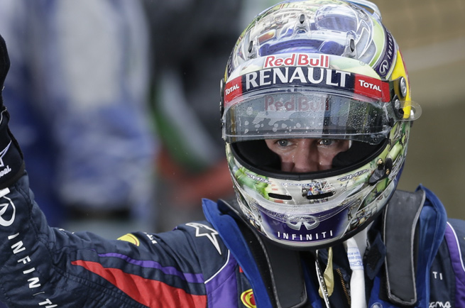 Sebastian Vettel conquered a wet track in Sao Paulo to take the pole for the Brazilian Grand Prix.