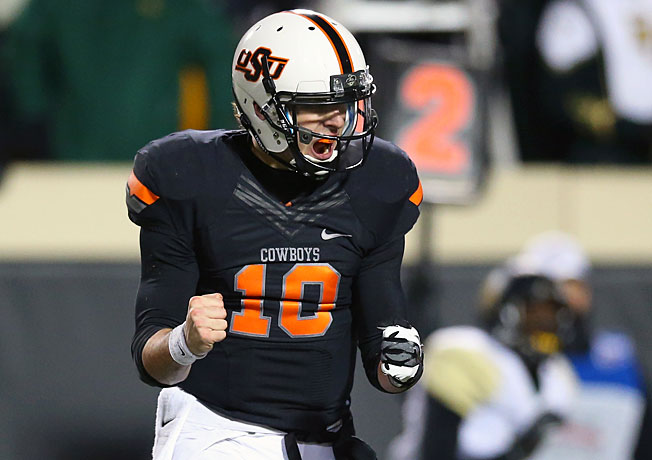 Oklahoma State QB Clint Chelf passed for a career-high 370 yards in the Cowboys' 49-17 rout of Baylor.
