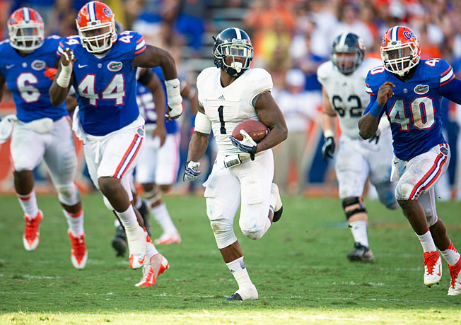 Jerick McKinnon (1) and Georgia Southern racked up 429 rushing yards in Saturday's upset of Florida.