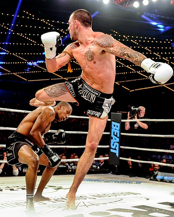 American Lightweight kickboxing contender Ky Hollenbeck connects with a flying knee en route to victory at GLORY 12 New York in the Theater at Madison Square Garden.
