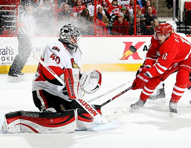 Senators goalkeeper Robin Lehner eyes a shot from Hurricanes forward Eric Staal.