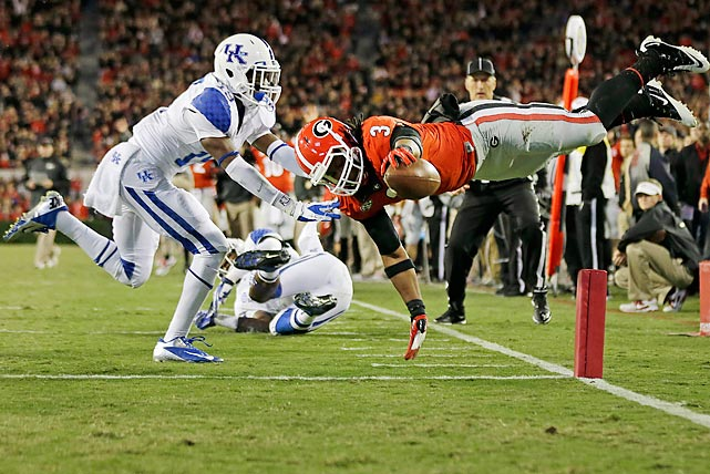 Georgia running back Todd Gurley leaps past Kentucky cornerback Jaleel Hytchye to score on an Aaron Murray pass.
