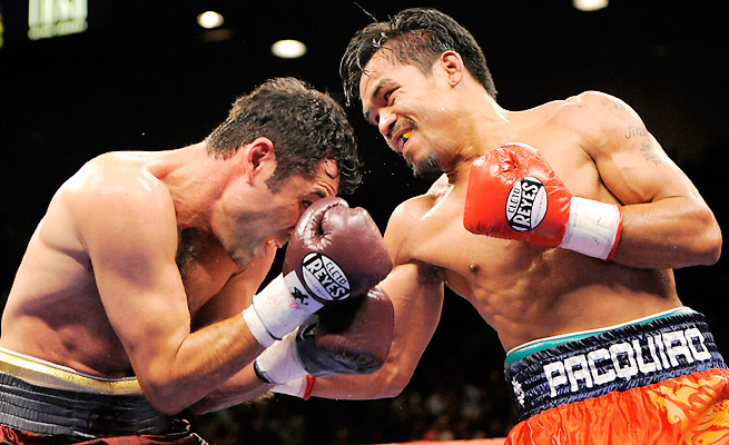 Manny Pacquiao says he paid taxes on his earnings from a 2008 fight with Oscar de la Hoya in the U.S.