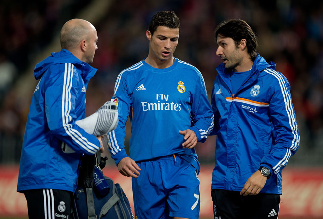 Real Madrid's Cristiano Ronaldo walks off the field during Saturday's match against Almeria with a hamstring injury.