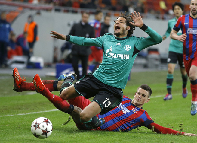 U.S. and Schalke midfielder Jermaine Jones gets chopped down by Steaua Bucharest's Florin Gardos in Tuesday's 0-0 Champions League draw.