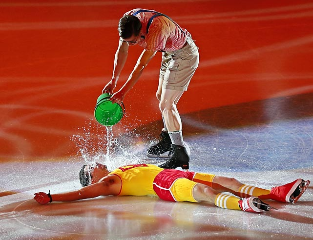 Staying properly hydrated is essential to strong performance in sports. Here we have Richard Dornbush of the U.S. and Spain's Javier Fernandez (on the ice) demonstrating the proper technique at a gala exhibition in Moscow.