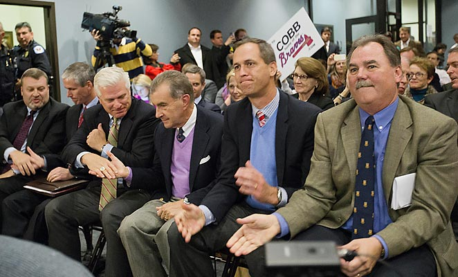 Braves officials celebrate approval to build a new stadium in Cobb County in suburban Atlanta.