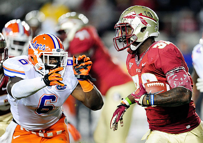 James Wilder Jr. (32) and the Seminoles look to run past Dante Fowler Jr. (6) and the reeling Gators.