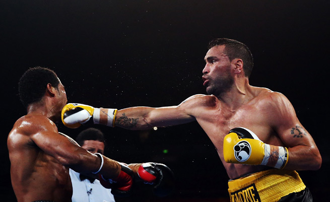 Anthony Mundine lands a right on Shane Mosley in their WBA international super welterweight bout in Sydney, Australia, on Wednesday.