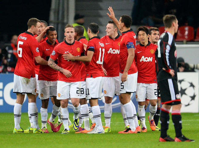 Manchester United celebrates after Nani's goal in a 5-0 Champions League rout of Bayer Leverkusen.