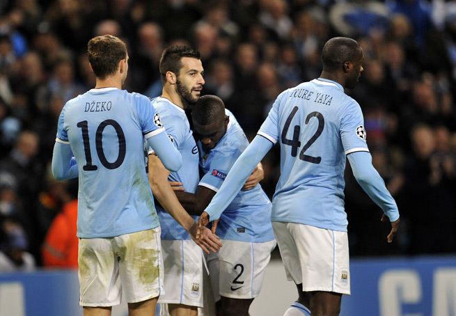 Alvaro Negredo gets a hug from Micah Richards after scoring the go-ahead goal in Manchester City's Champions League win over Viktoria Plzen.
