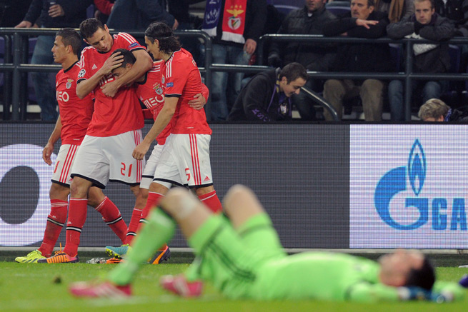 Benfica's Rodrigo, third from the left, is congratulated by teammates after scoring the game-winning goal in the Portuguese side's 3-2 win over Anderlecht.