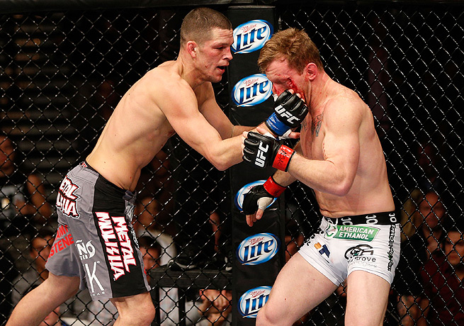 Nate Diaz (left) bloodied Gray Maynard during the deciding sequence in the first round.