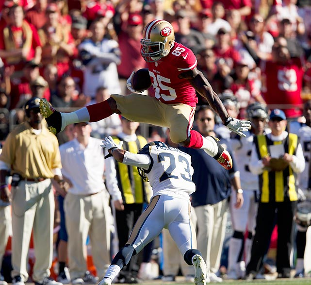 San Francisco 49ers tight end Vernon Davis hurdles St. Louis Rams safety Rodney McLeod during an NFC West matchup Sunday. McLeod was one of several Rams defenders Davis hurdled, including a fourth-quarter score converted by leaping over cornerback Janoris Jenkins.
