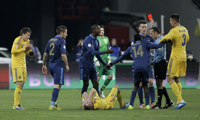 France's Laurent Koscielny, being shown red against Ukraine in the first leg of their UEFA World Cup qualifying playoff, will not face further punishment and will be available for the start of this summer's World Cup.