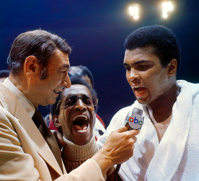 "It's not often that anyone talked over Ali, but Leifer captured this image of an evidently amped-up Sammy Davis Jr., interjecting himself into Howard Cosell's interview of Ali after his 1973 victory over European champion Joe Bugner. Although Ali won easily, he praised Bugner's effort and said that ""Aussie Joe"" could be a champion in a few years. Click here for Neil Leifer's fine art photography."