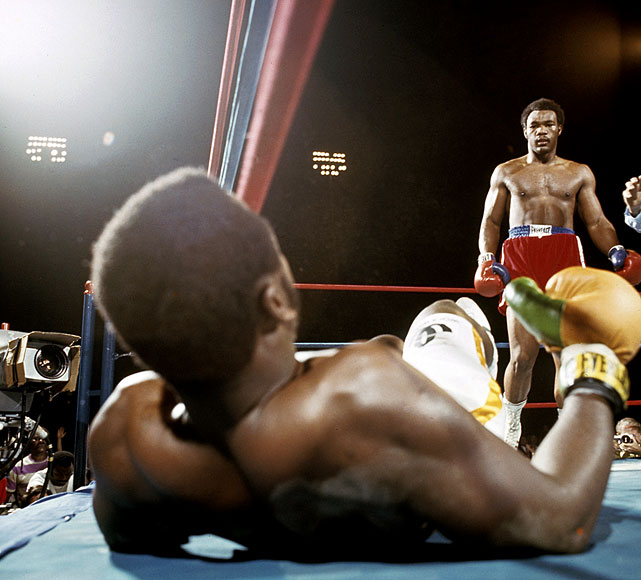 """Down goes Frazier!"" Howard Cosell's memorable call provided a dramatic soundtrack to Foreman's shocking two-round destruction of Frazier in Kingston, Jamaica, on Jan. 22, 1973. With the win, Foreman claimed the heavyweight title and set himself up as the most feared puncher in the sport. Click here for Neil Leifer's fine art photography."