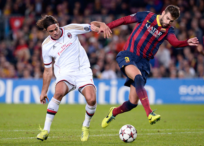 "Barcelona defender Gerard Pique, right, says that ""the exit door is always open"" for the club's unhappy players."