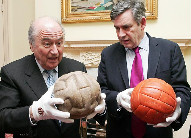 FIFA's President Sepp Blatter, left, holds a ball used in the 1930 Soccer World Cup as he meets in London, Wednesday, Feb. 28, 2007, with Britain's Chancellor of the Exchequer, Gordon Brown, right, who holds a 1966 Soccer World Cup ball.