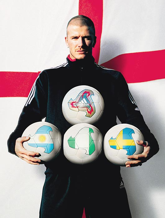 David Beckham holding the adidas Fevernova, the official matchball for the FIFA World Cup 2002 Finals.