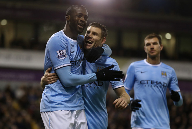 Yaya Toure and James Milner celebrate after the former's goal in Manchester City's 3-2 win at West Brom Wednesday.