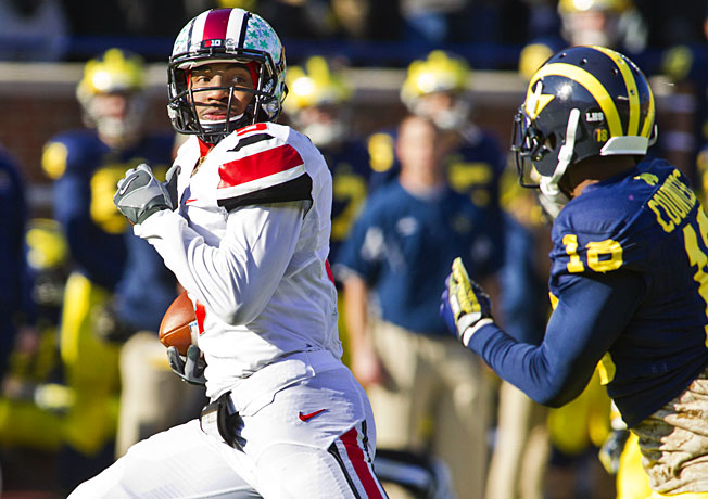 Even if Braxton Miller (5) and Ohio State win on Saturday, it's no lock they'd play in the BCS title game.
