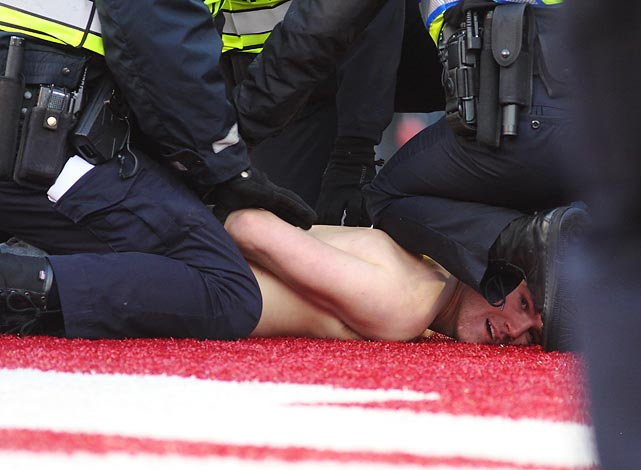 Overcome by a fervent desire to join in Wisconsin's 51-3 rout of Penn State at Camp Randall Stadium, this young man was sacked by ever-vigilant law enforcement and unceremoniously carted off to an uncertain fate.