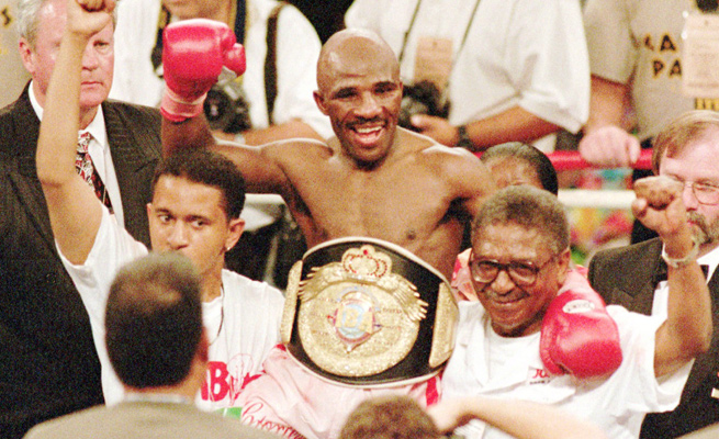 'Baby Jake' Matlala celebrates his 1997 TKO over Michael Carbajal to win the IBA light flyweight belt. Matlala passed away on Saturday at the age of 51.