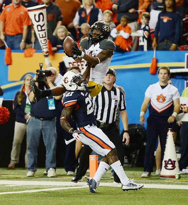 Missouri wide receiver Bud Sasser rises above Auburn safety Robenson Therezie for a catch in the end zone but is unable to come down with the ball in bounds. Sasser finished the SEC Championship Game with three catches for 34 yards while No. 3 Auburn held off the No. 5 Missouri and earned a berth the BCS National Championship game.