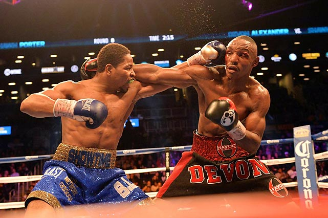 Shawn Porter barely connects with a left to the face of Devon Alexander during their bout Saturday. Porter won by unanimous decision to take Alexander's welterweight world title.