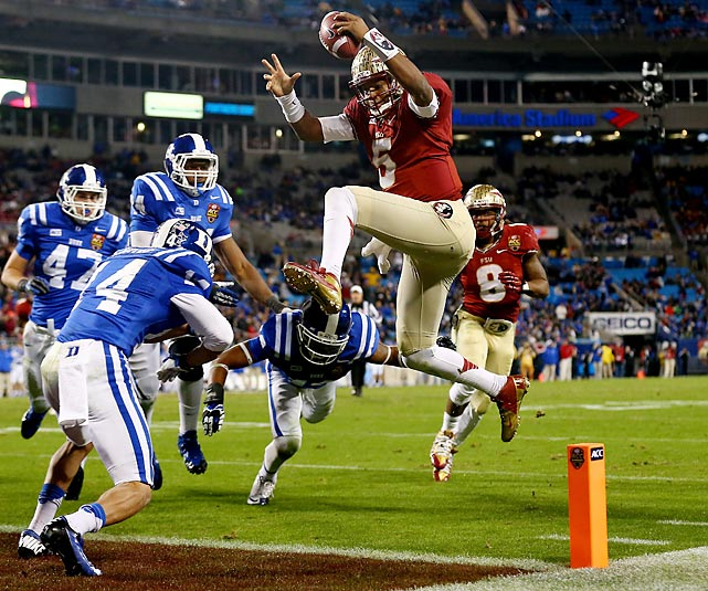 Florida State quarterback Jameis Winston leaps into the end zone in the ACC Championship Game against Duke on Saturday. Winston contributed four touchdowns as the No. 1 Seminoles routed the No. 20 Blue Devils to book their ticket to the national title game.