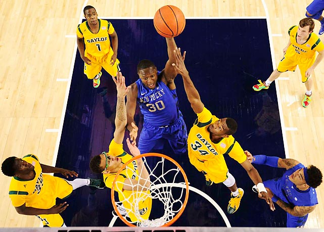 Kentucky forward Julius Randle rises above the Baylor defense for a dunk in Friday's game. Randle, likely one of the top picks in next year's NBA Draft, contributed 16 points and eight rebounds in the Wildcats' loss.