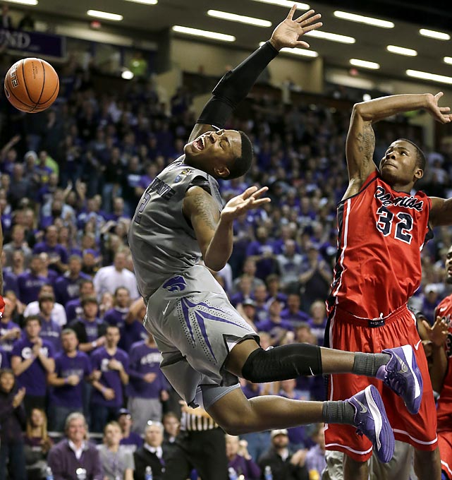 Kansas State guard Marcus Foster attempts to draw a foul while putting up a shot against Ole Miss guard Jarvis Summers in the second half of a game Thursday. The Wildcats got their first win over the Rebels in five contests, led by Foster's 15 points.