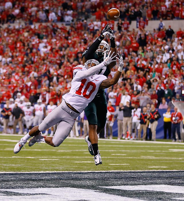 Michigan State safety Kurtis Drummond breaks up a pass in the end zone intended for Ohio State wide receiver Corey Brown in the Big Ten Championship Game on Saturday. It was a frustrating night for the Buckeyes' passing game as quarterback Braxton Miller completed just 8-of-21 passes in the loss.
