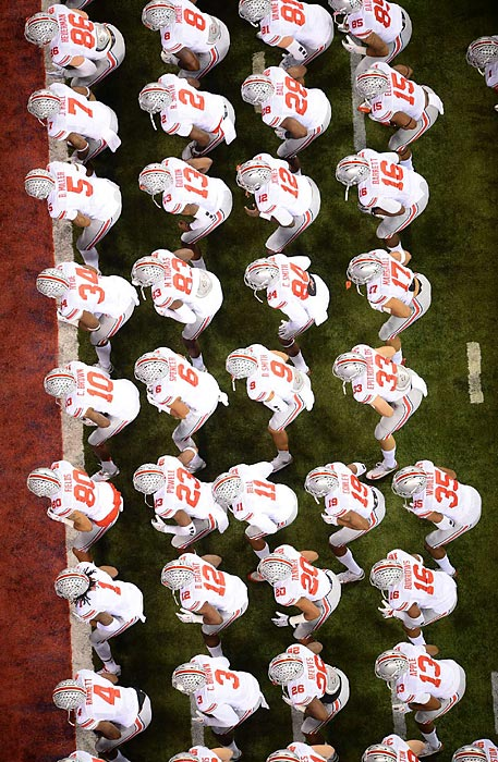 The Ohio State Buckeyes warm up before their Big Ten Championship Game against Michigan State on Saturday. Needing a win to secure a likely berth in the national title game, the No. 2 Buckeyes were stunned by the No. 10 Spartans for a 34-24 loss.