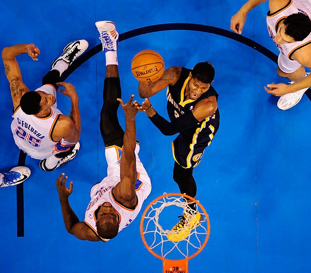 The Indiana Pacers and Oklahoma City Thunder battle in the paint during a game in Oklahoma City on Sunday. Forward Kevin Druant sparked a 118-94 home win for the Thunder with 36 points and 10 rebounds.