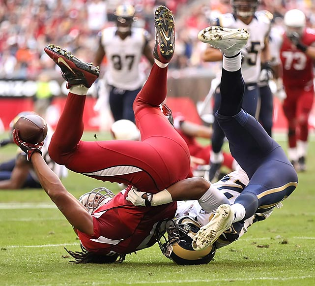 Arizona Cardinals wide receiver Larry Fitzgerald holds the ball aloft to complete an acrobatic catch against the St. Louis Rams on Sunday. The Cardinals snapped an eight-game NFC West losing streak in their 30-10 victory, spurred by a strong connection between quarterback Carson Palmer and Fitzgerald, who caught 12 passes for 96 yards and a touchdown.