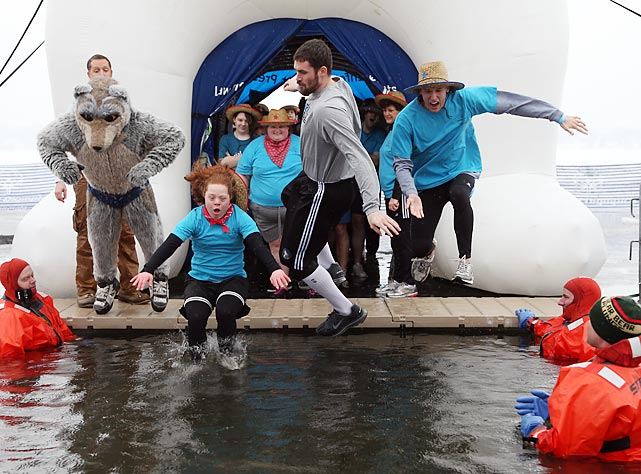 Love takes a dip during an event for Special Olympics in March 2013.