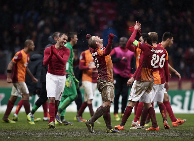 Galatasaray's Wesley Sneijder, center, celebrates his goal that eliminated Juventus and put his team in the Champions League knockout stage.