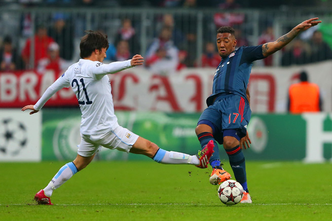 Bayern Munich defender Jerome Boateng, right, has signed a contract extension with the German club through 2018.