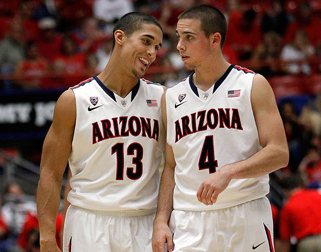 Nick Johnson (left) helped bring T.J. McConnell to Tucson to point the way for the No. 1 Wildcats.