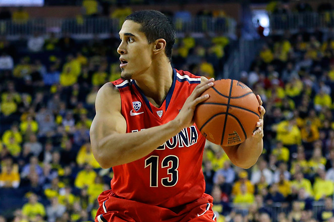 Arizona hit 14 of 15 free throws, including six straight in the final minute by guard Nick Johnson.